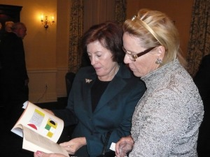 Mrs. Larry Silberman, wife of Judge Larry Silberman and an owner of a Namingha painting, discusses the brochure from the Namingha Exhibit at the Federal Reserve Building in Washington DC with Mrs. Frank Carlucci, wife of the former Secretary of Defense, Frank Carlucci.
