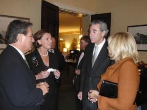 Dan Namingha, left, and Ann Korologos discuss the Namingha Exhibit at the Federal Reserve building with former Secretary of Commerce and Mrs. Gutierrez at a dinner at the Metropolitan Club in Washington DC.